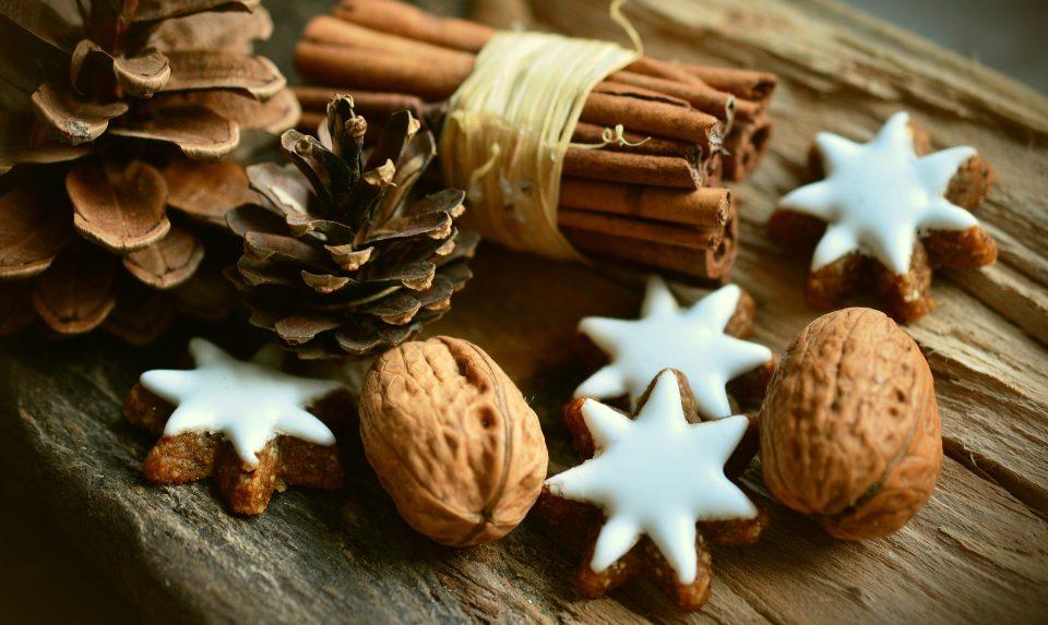 christmas season items walnuts, cinnamon sticks and stars