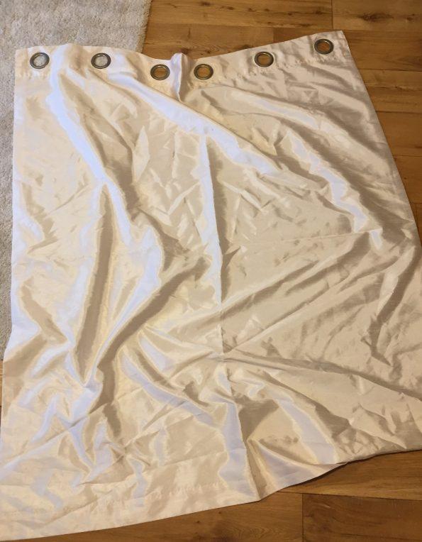 cream curtain on the floor