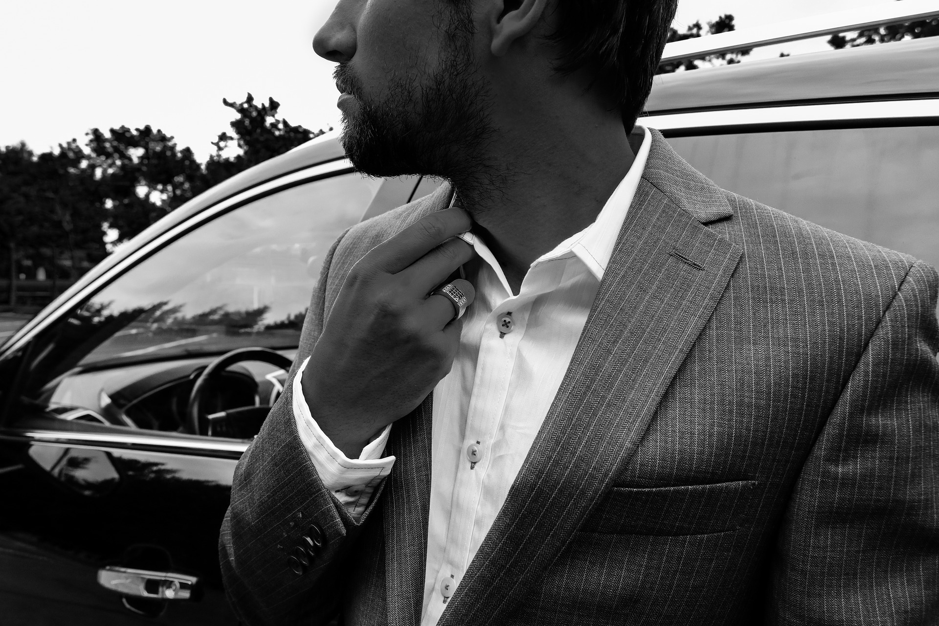 black and white photo of a man in a suit looking smart and on style