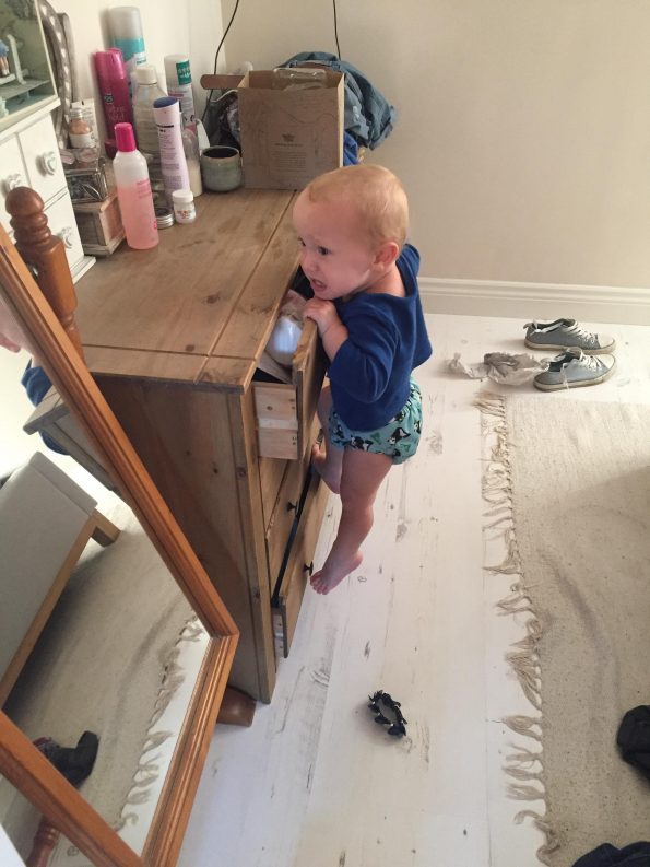 William climbing the chest of drawers