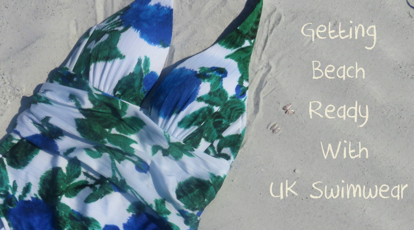 getting beach ready with UK swimwear written on the sand area of the photo with the swimsuit to the left