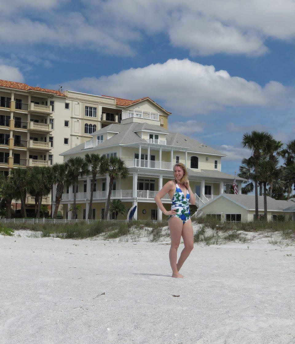 me stood on a beach in Florida wearing my UK Swimwear costume