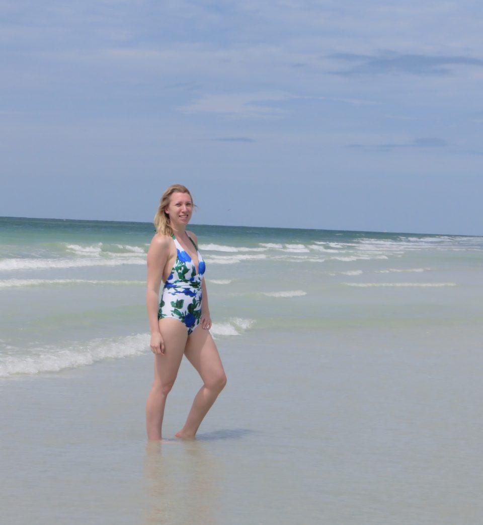 me stood in the sea wearing my swimsuit from UK swimwear
