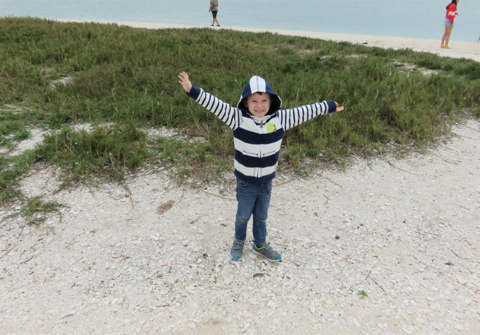 Jake with his arms open on the island
