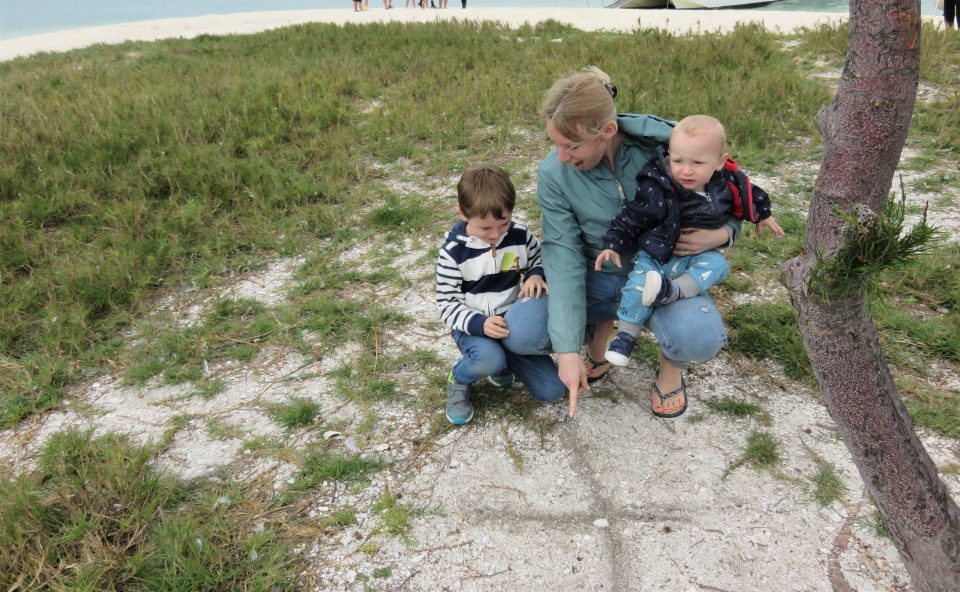 x marks the spot on the sand with me pointing and Jake looking at it