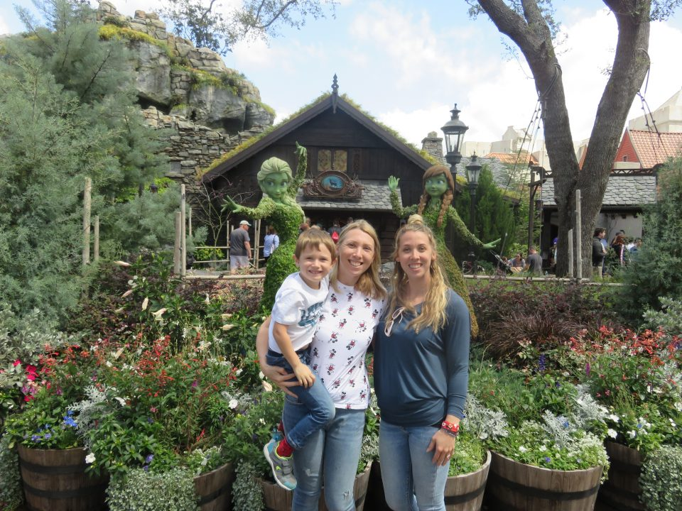 me, my sister and Jake in front of Anna and Elsa topiary bushes