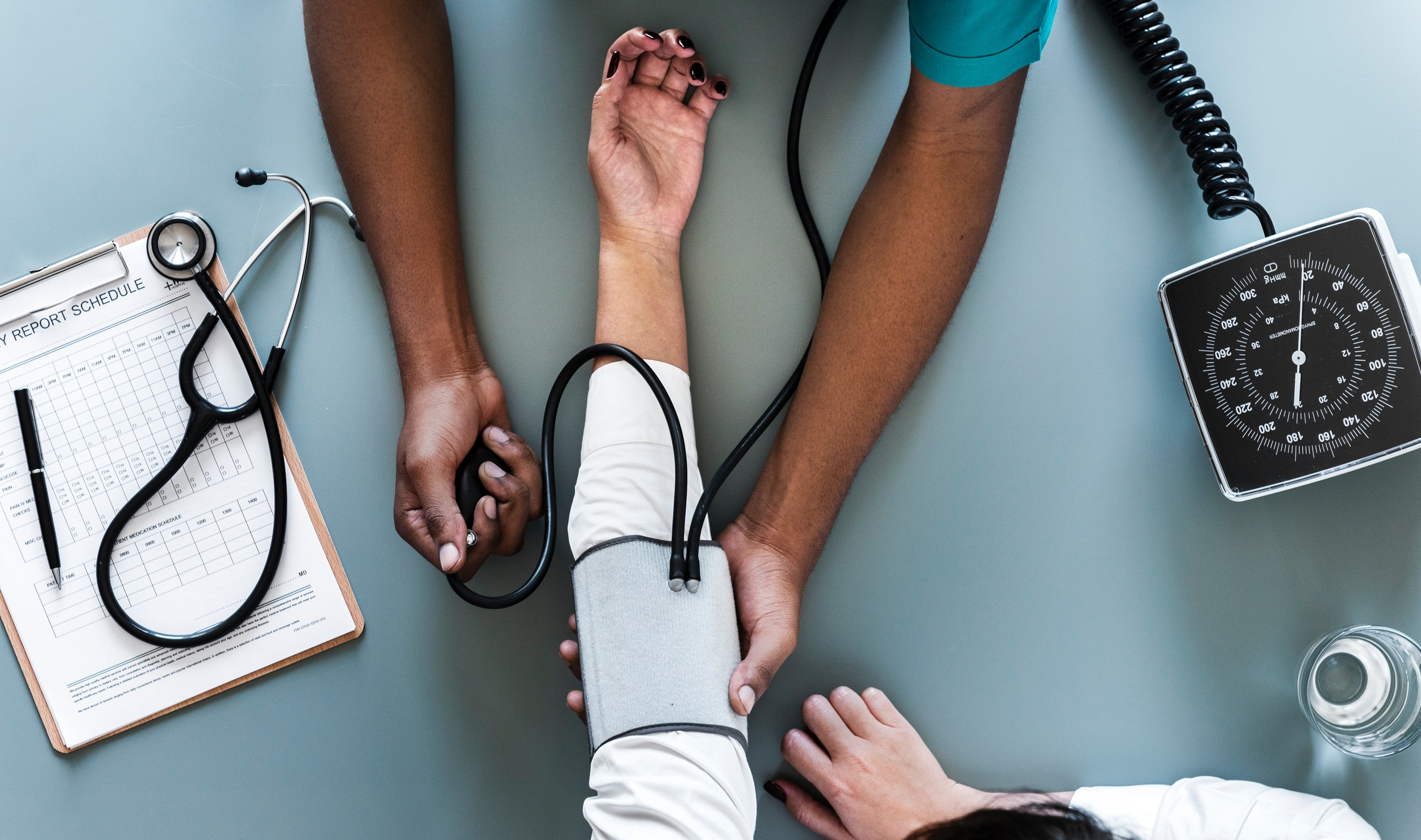 arm laying out having blood pressure taken by a medical professional
