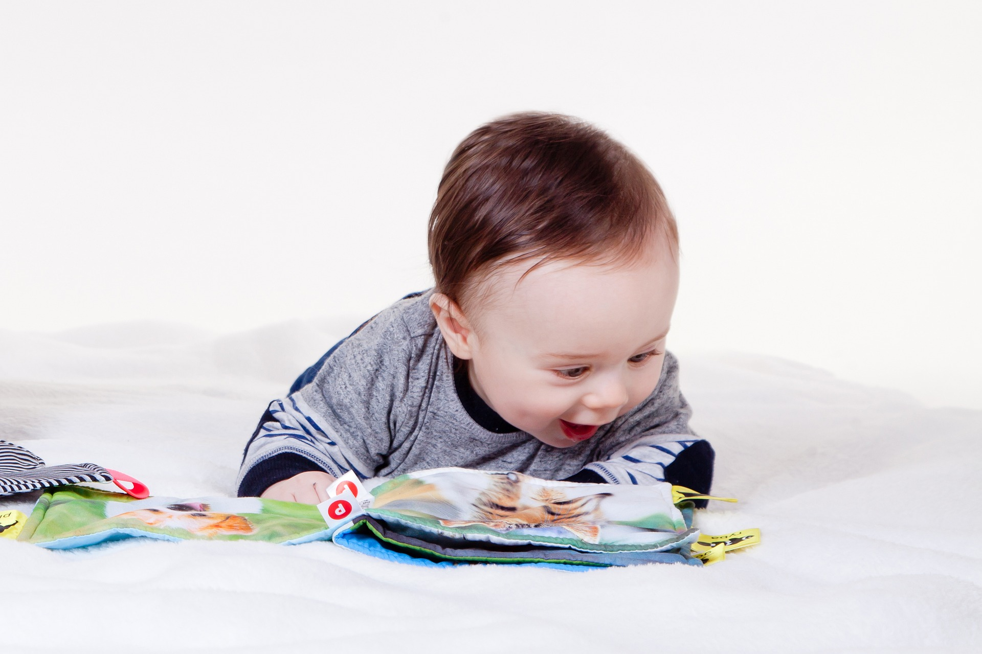 baby learning from a book
