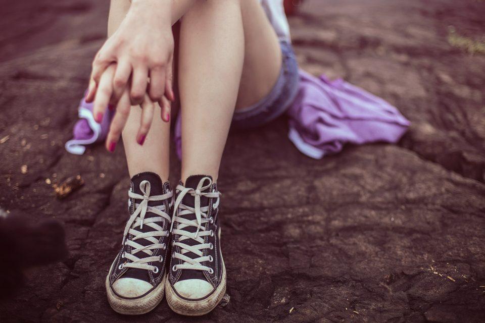 teen girls legs, shoes in converse