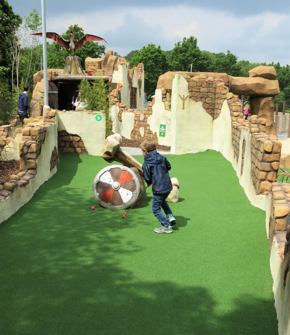 Jake on the part of the course with shields at mighty claws adventure golf