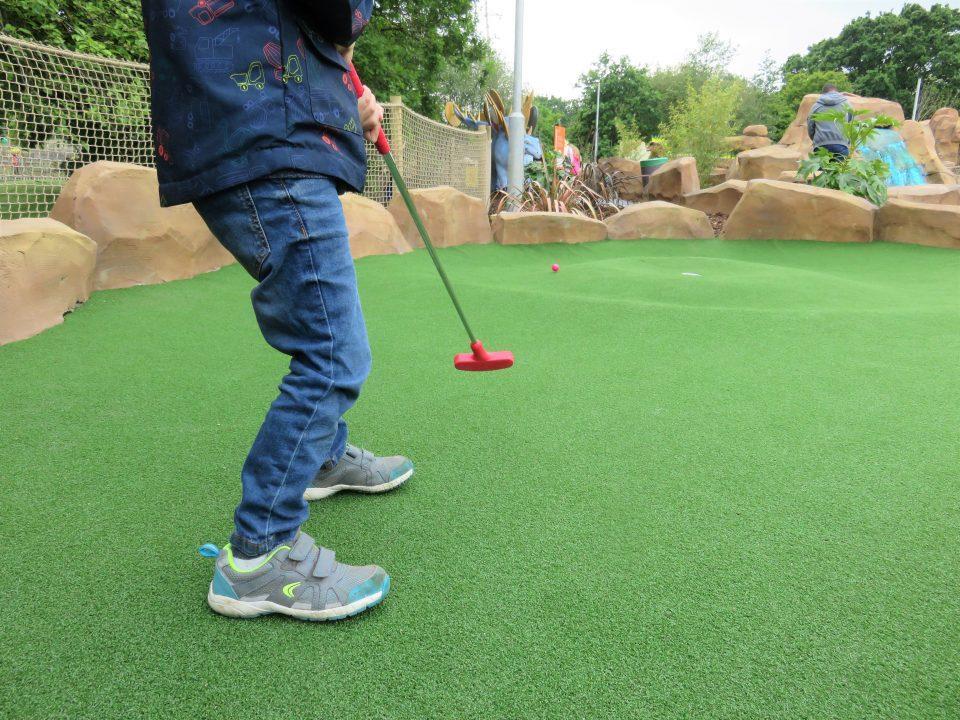 Jake's feet taking a golf shot