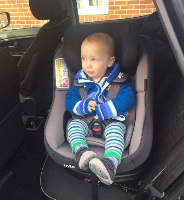 toddler sat in the Joie spin 360 facing the car door