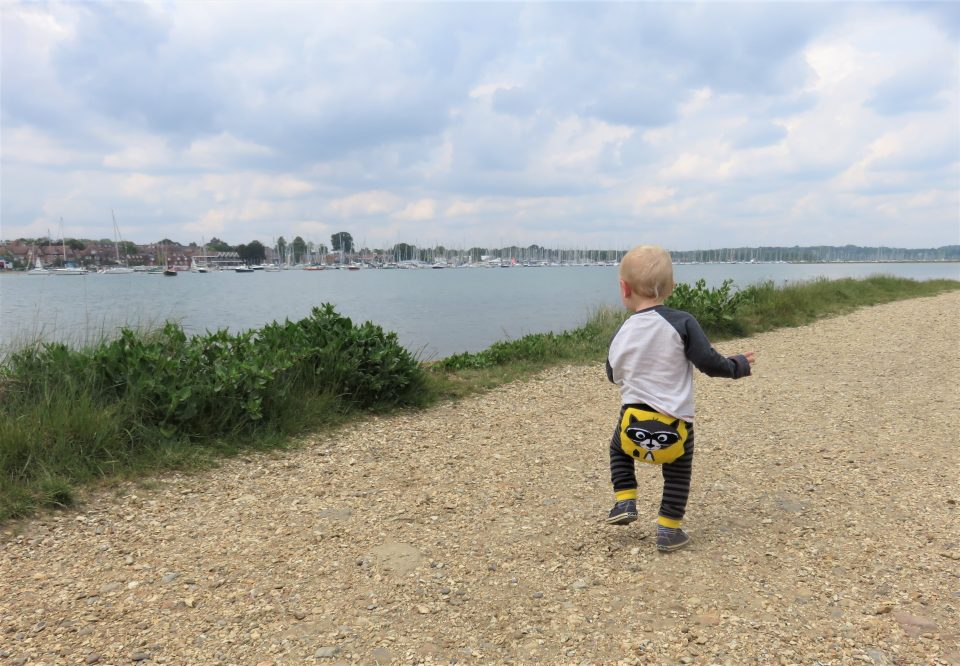 William walking on a gravel path with his back to us wearing the Ziggle raccoon leggings