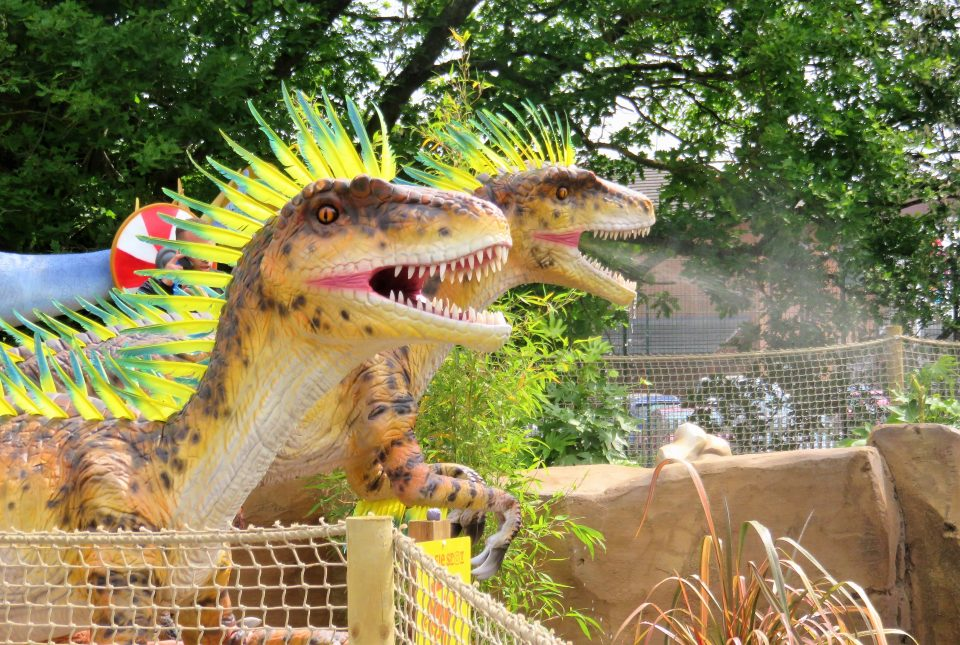 raptors that spray water at mighty claws adventure golf