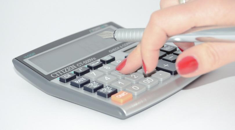 hand on a calculator