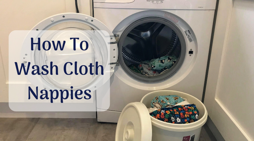 how to wash cloth nappies written by a washing machine with cloth nappies going in