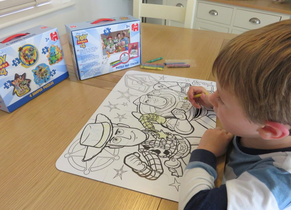 Jake colouring in the Toy story 4 puzzle