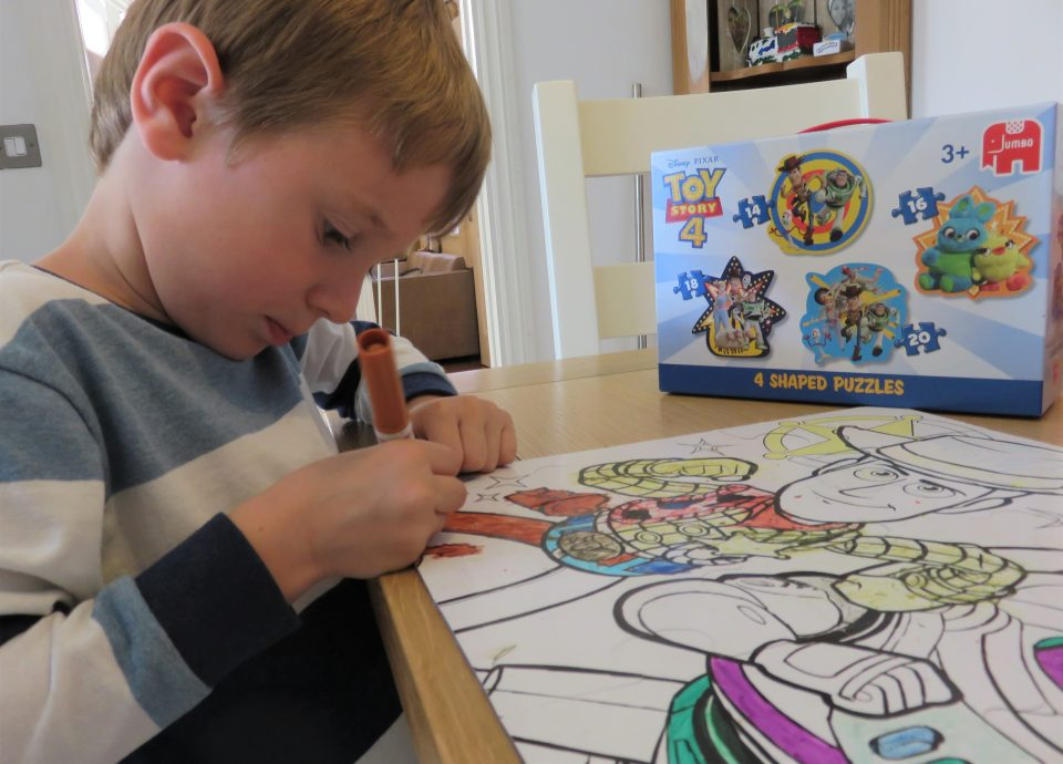 Jake using felt tips instead of crayons to colour in