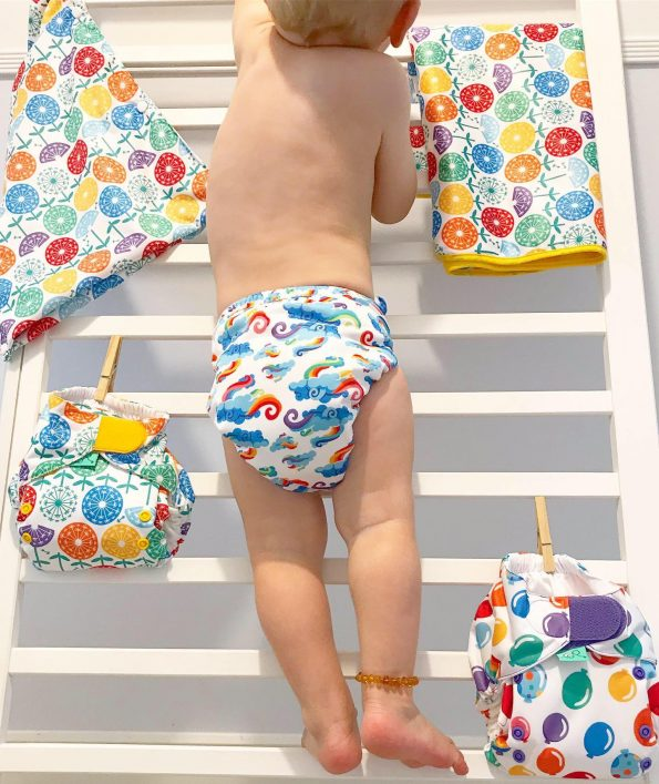William climbing to get to reusable nappies