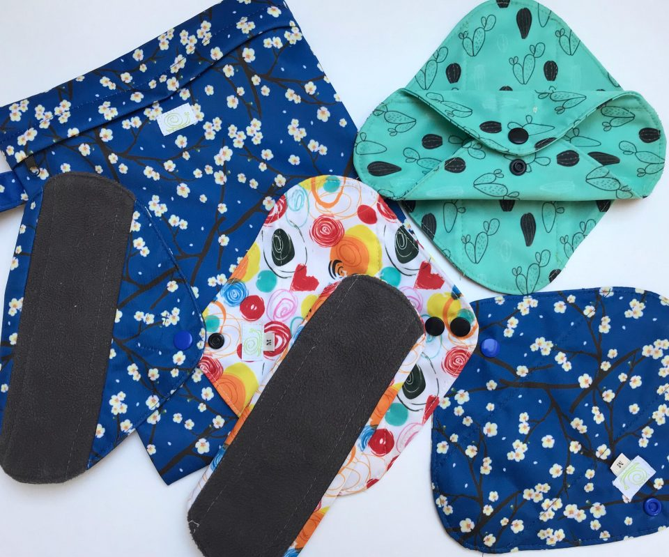 cloth sanitary pads laid out on a white background