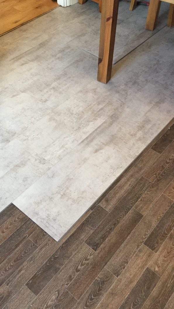 the kitchen floor being laid