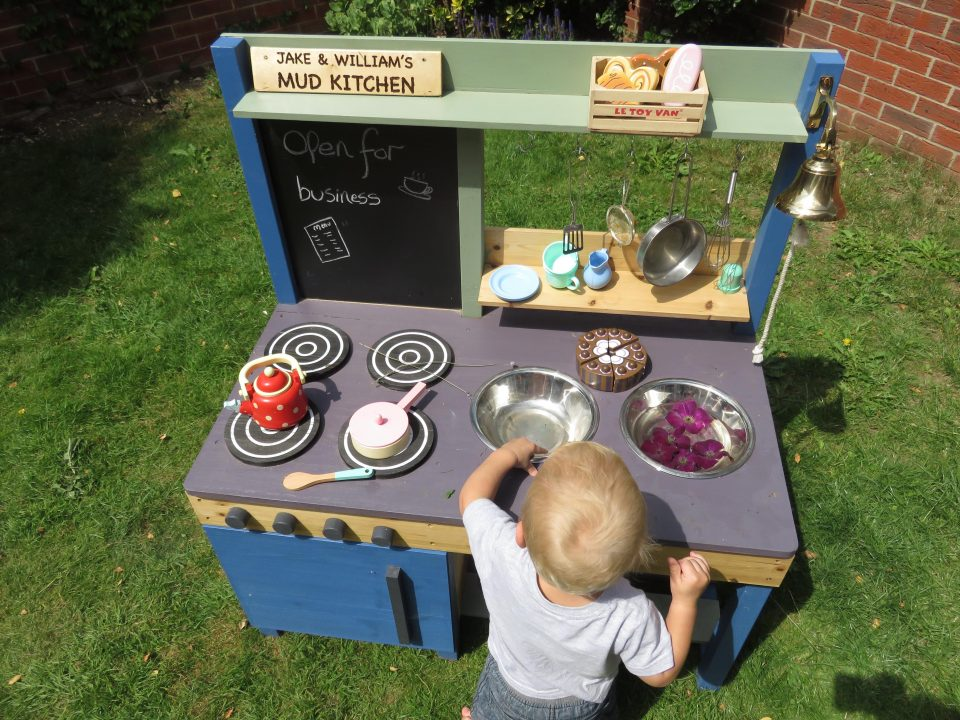 William playing with his mud kitchen