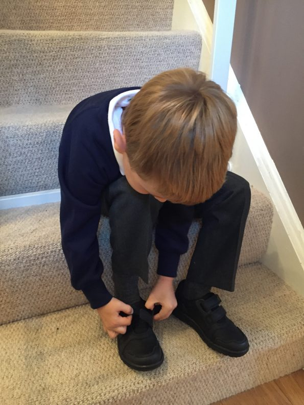 Jake trying on shoes ready for the start of reception