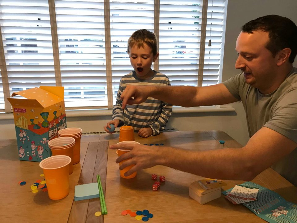 rob showing Jake how to do the game