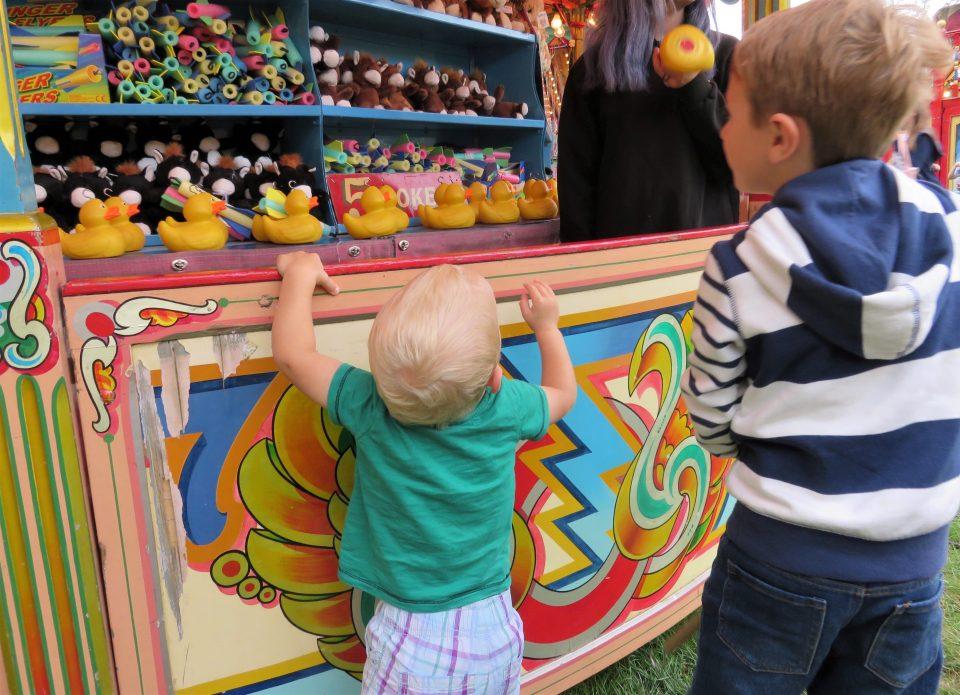boys doing hook a duck