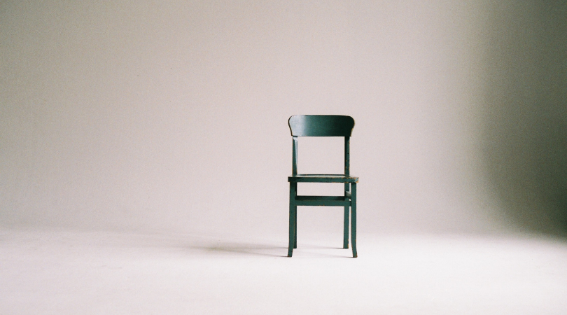 chair in a room on its own to symbolise a minimalist lifestyle