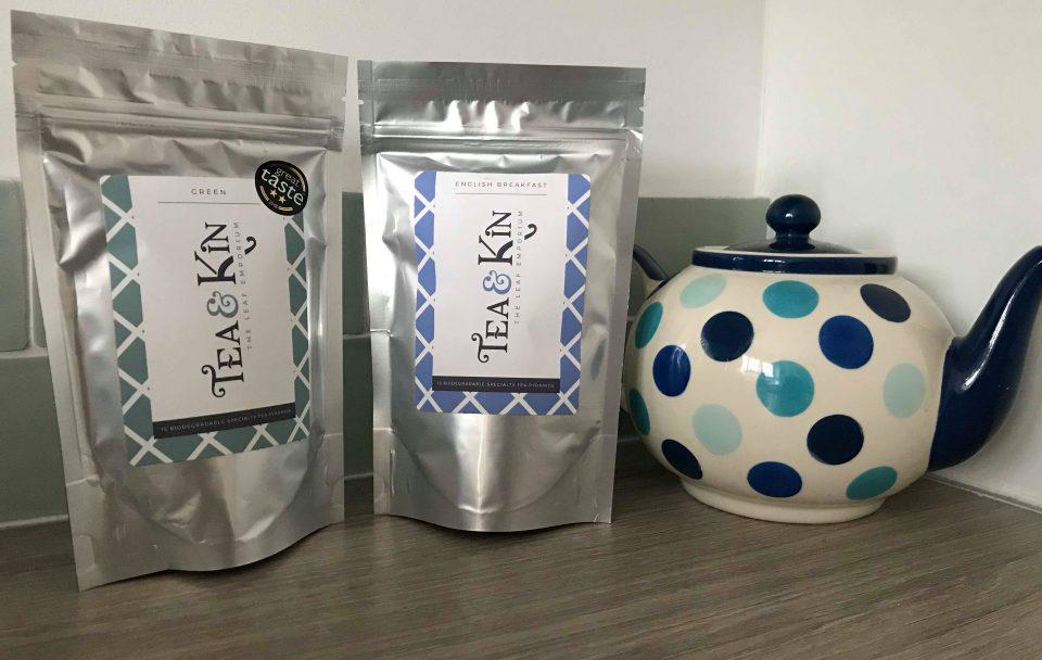 the english breakfast tea and green tea next to a teapot