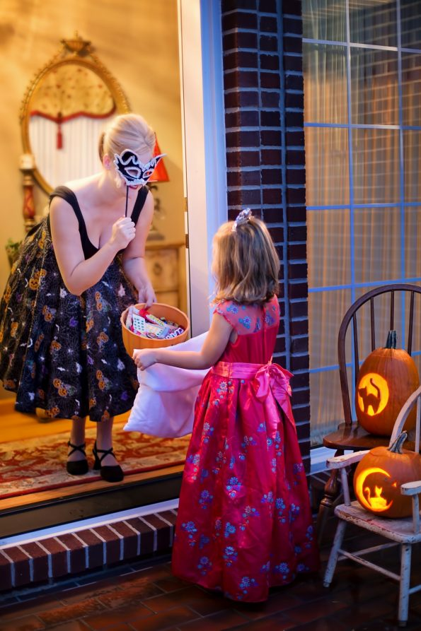 little girl going trick or treating using a pillow case as an eco-friendly halloween option