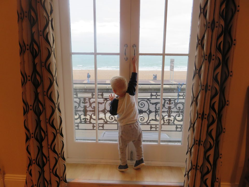 william at the french doors in the apartment