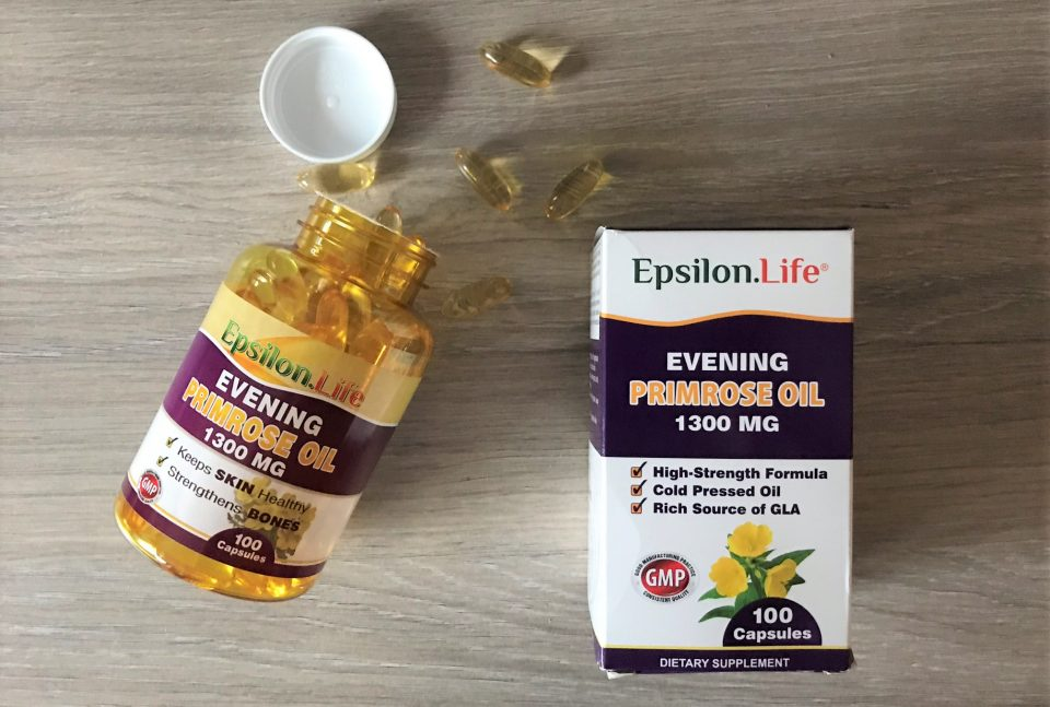 epsilon evening primrose oil tablets scattered on the kitchen top