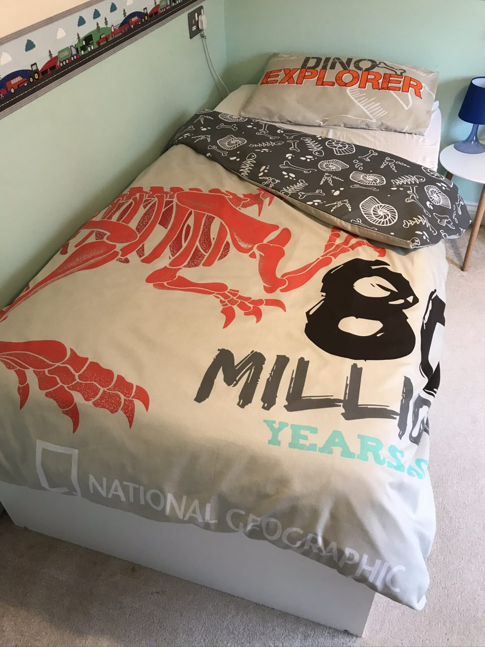 the recycled bedding set on the bed with the corner of the duvet pulled back