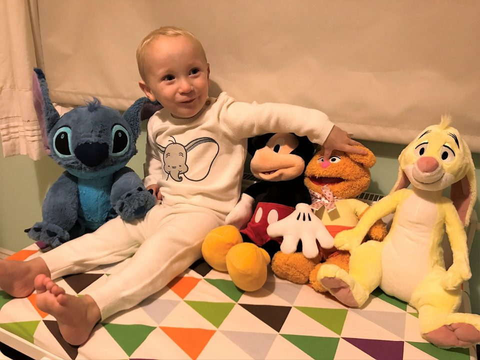 William in his Dumbo outfit whilst sitting with his new plush toys from shopDisney