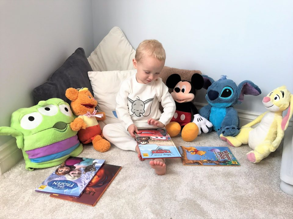 William with a Disney Book and his Disney toys