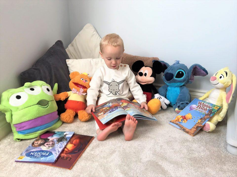 William reading to his Disney toys