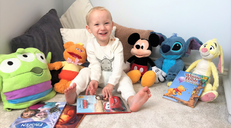shopDisney products with William sat reading a book