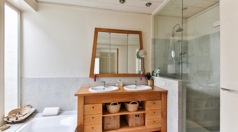 a bathroom with a pine dresser