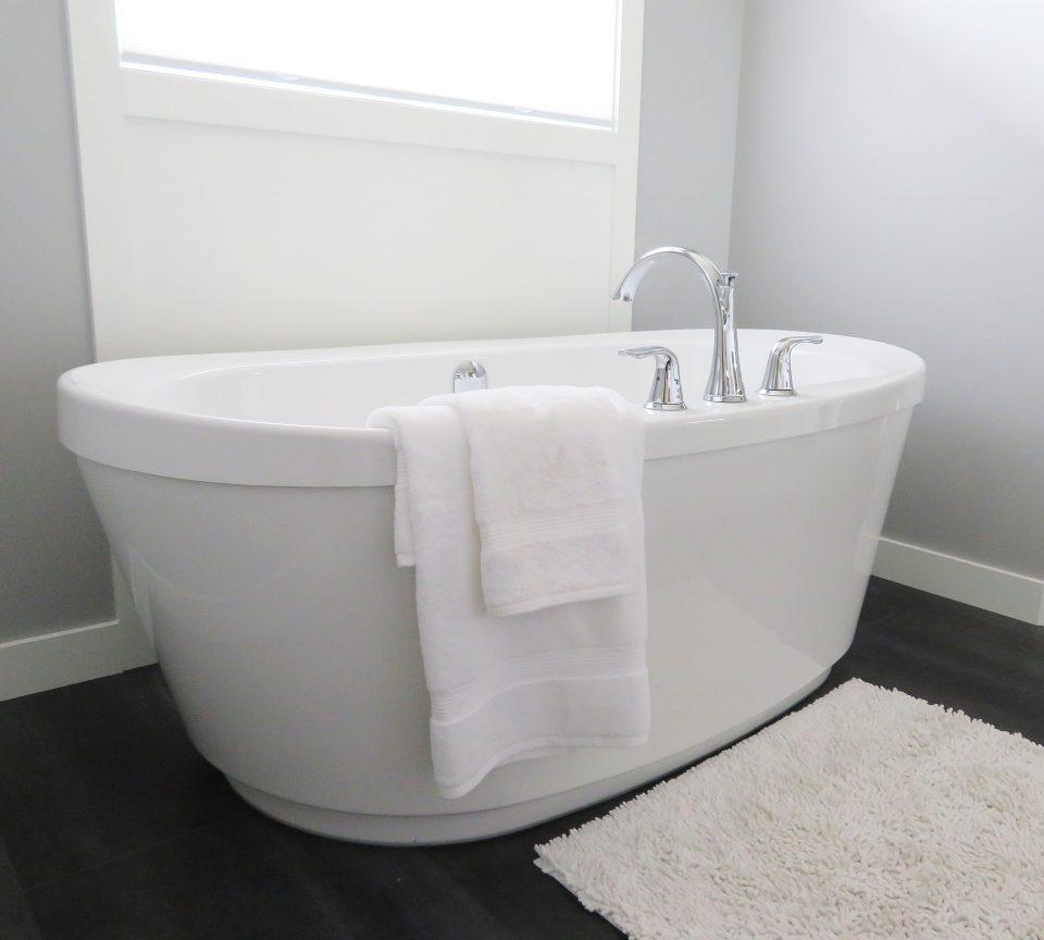 bath with rug and towel