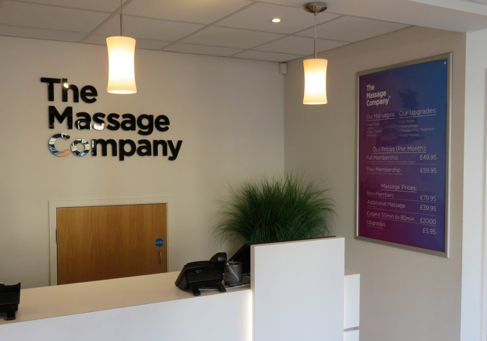 the massage company reception and sign with prices
