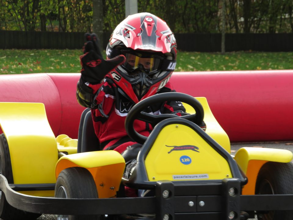 child in go-kart at barracudas activity day camp