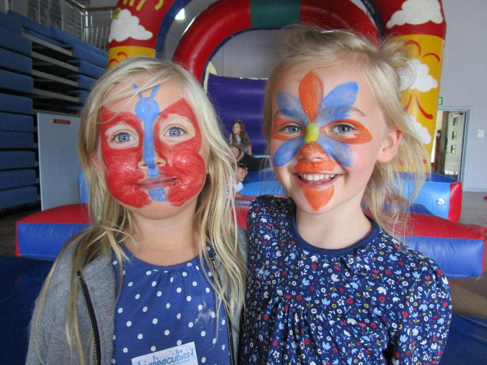 girls with facepainted faces at Barracudas activity day camp
