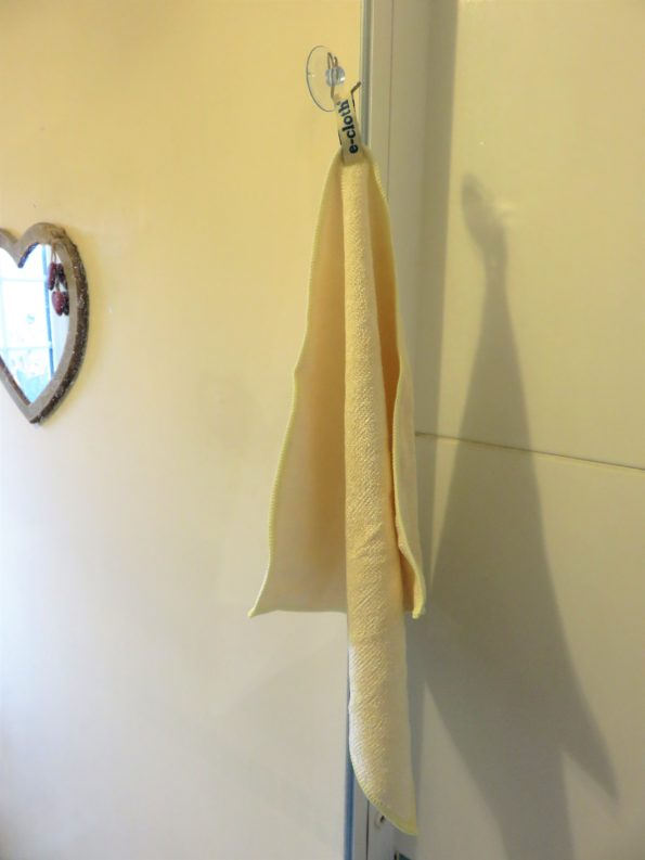cloth hanging on a hook in the shower