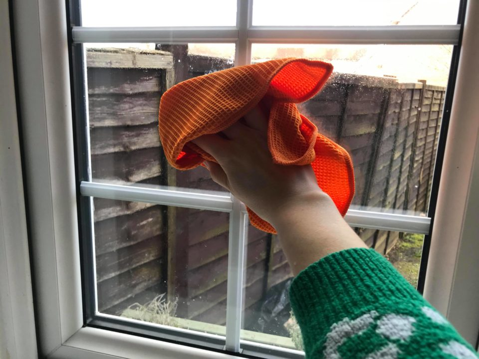 cleaning the windows with the orange e-cloth