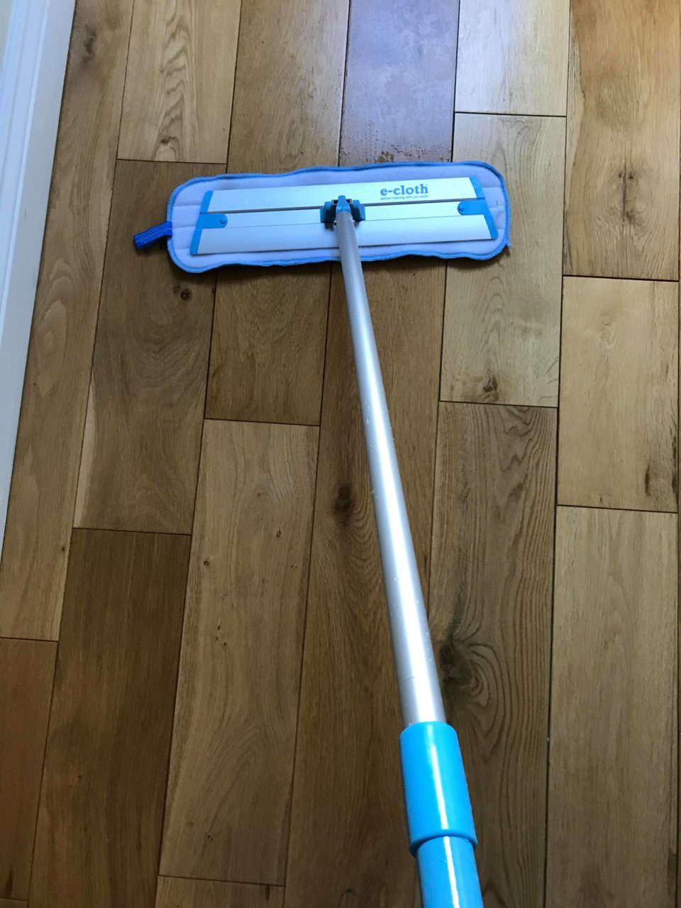 mopping the wooden floor with the e-cloth mop