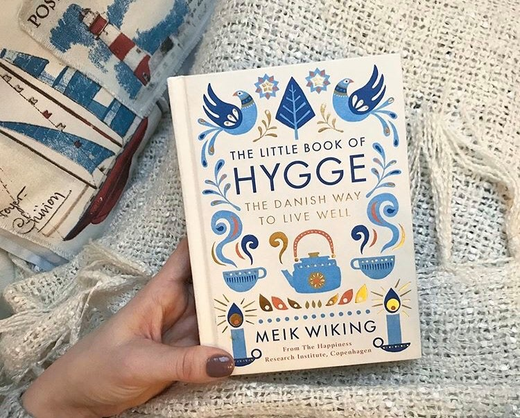 holding the little book of Hygge