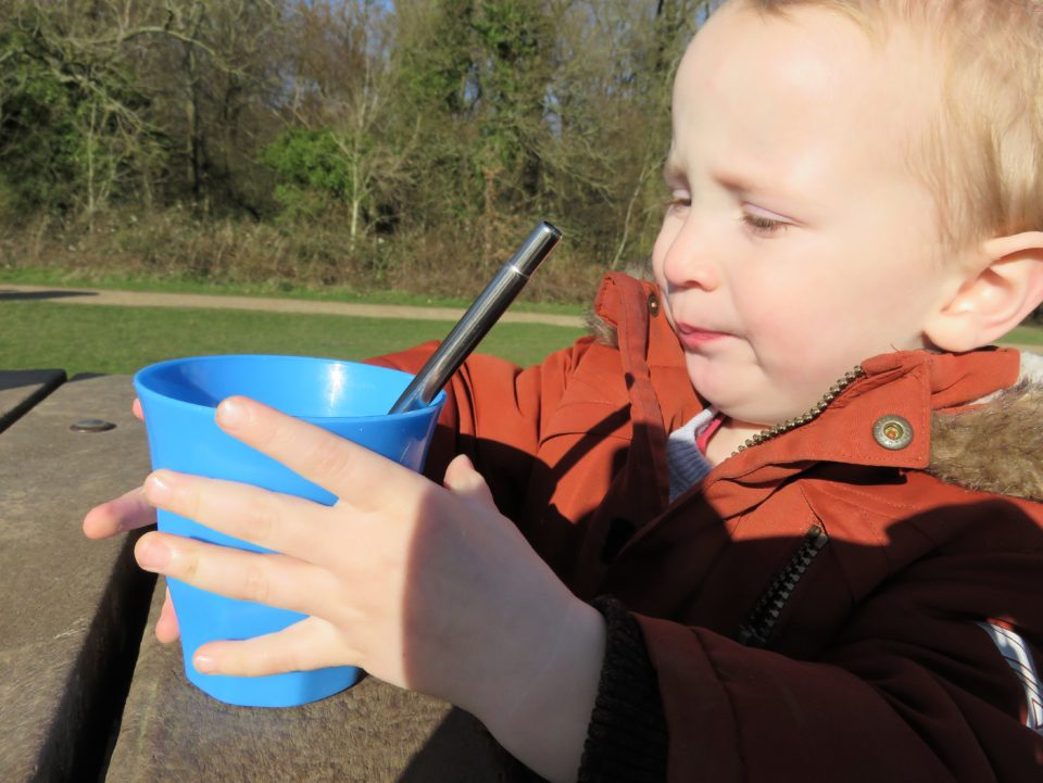 william about to drink his water through a straw