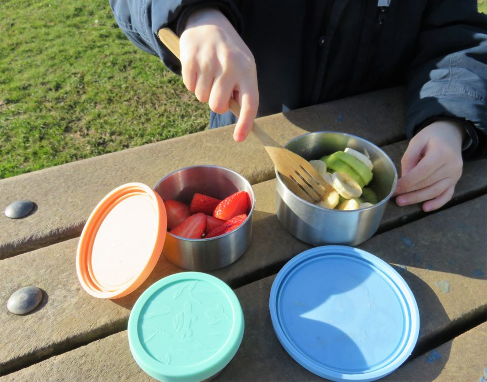 eating fruit out of the triad pots